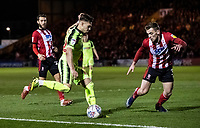 Bolton Wanderers' Dennis Politic competing with Lincoln City's Harry Toffolo (right) <br /> <br /> Photographer Andrew Kearns/CameraSport<br /> <br /> The EFL Sky Bet League One - Lincoln City v Bolton Wanderers - Tuesday 14th January 2020  - LNER Stadium - Lincoln<br /> <br /> World Copyright © 2020 CameraSport. All rights reserved. 43 Linden Ave. Countesthorpe. Leicester. England. LE8 5PG - Tel: +44 (0) 116 277 4147 - admin@camerasport.com - www.camerasport.com
