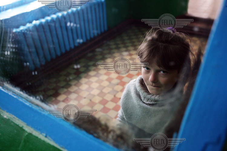 A young girl at boarding school. There are 262 children, aged between seven and 18 years, at the school. Many of them are there because their parents have gone abroad to find work.