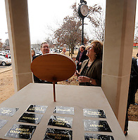NWA Media/ J. T. WAMPLER- Jim, left, and Gaye Cyoert get a look at the Springdale Public Schools Education Foundation's new monument outside the school district administration building Friday Dec. 12, 2014. The monument features the names of Springdale Public Schools Education Foundation donors.