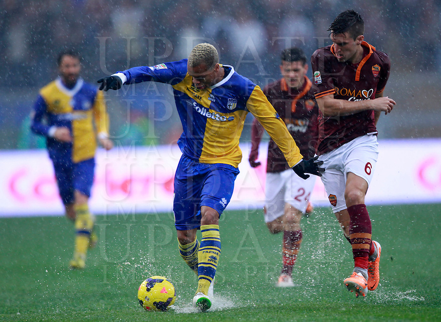 Calcio, Serie A: Roma vs Parma. Roma, stadio Olimpico, 2 febbraio 2014.<br /> Parma forward Jonathan Ludovic Biabiany, of France, is challenged by AS Roma midfielder Kevin Strootman, of the Netherlands, right, during the Italian Serie A football match between AS Roma and Parma, due to heavy rain, at Rome's Olympic stadium, 2 February 2014. The match was suspended after few minutes due to heavy rain.<br /> UPDATE IMAGES PRESS/Isabella Bonotto