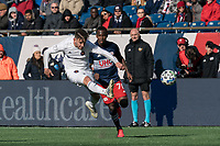 FOXBOROUGH, MA - MARCH 7: Alvaro Medran #10 of Chicago Fire passes the ball as Cristian Penilla #70 of New England Revolution closes during a game between Chicago Fire and New England Revolution at Gillette Stadium on March 7, 2020 in Foxborough, Massachusetts.