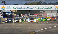 The field races down the front straighaway at the start of  the 12 Hours of Sebring, Sebring, FL, MArch 20, 2010.  (Photo by Brian Cleary/www.bcpix.com)