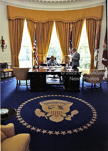 United States President Gerald R. Ford and Counsellor Robert Hartmann work in the Oval Office in the White House in Washington, D.C. on August 22, 1974.  <br /> Mandatory Credit: David Hume Kennerly / White House via CNP