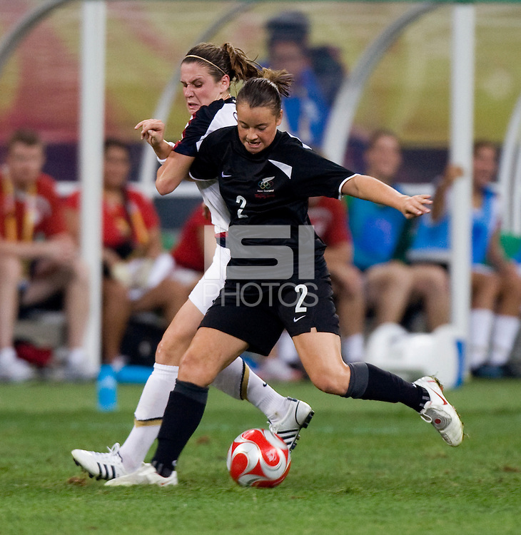 Ria Percival, Heather O'Reilly. The USWNT defeated New Zealand, 4-0, during the 2008 Beijing Olympics in Shenyang, China.  With the win, the USWNT won group G and advanced to the semifinals.