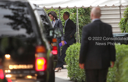 United States President Barack Obama and first Lady Michelle Obama head from the White House to the Presidential motorcade for dinner at Tosca Restaurant on Saturday, May 7, 2011. .Credit: Dennis Brack / Pool via CNP