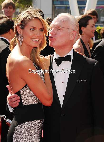 LOS ANGELES, CA- SEPTEMBER 15: TV personalities Heidi Klum and Tim Gunn attend the 2013 Creative Arts Emmy Awards at Nokia Theatre L.A. Live on September 15, 2013 in Los Angeles, California.<br />