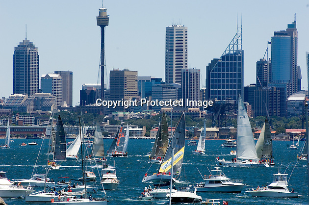 Sydney Harbour is crowded with boats in the hour before the start of the annual Sydney to Hobart yacht race on Boxing Day.