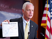 "United States Senator Ron Johnson (Republican of Wisconsin), one of several key Republican Senators, holds a chart as he announces he will not support the ""skinny repeal"" of the Affordable Care Act (ACA) unless he has assurances from US House leaders that the bill will never become law.  Instead they demand negotiations or they will kill the bill, in the US Capitol in Washington, DC on Thursday, July 27, 2017.  Looking on from right is US . <br /> Credit: Ron Sachs / CNP"