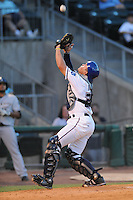 NWA Democrat-Gazette/ANDY SHUPE<br /> Northwest Arkansas Naturals catcher Parker Morin catches a popup on the infield against San Antonio Wednesday, Aug. 12, 2015, at Arvest Ballpark in Springdale.