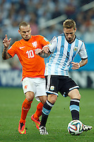 Lucas Biglia of Argentina and Wesley Sneijder of the Netherlands