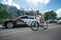 Patrick Gretsch (DEU/Ag2r-La Mondiale) getting rid of a Lotto-Belisol bottle (he got earlier) now that he can get supplies directly from the team car<br /> <br /> 2014 Giro d'Italia <br /> stage 17: Sarnonico - Vittori Veneto (208km)