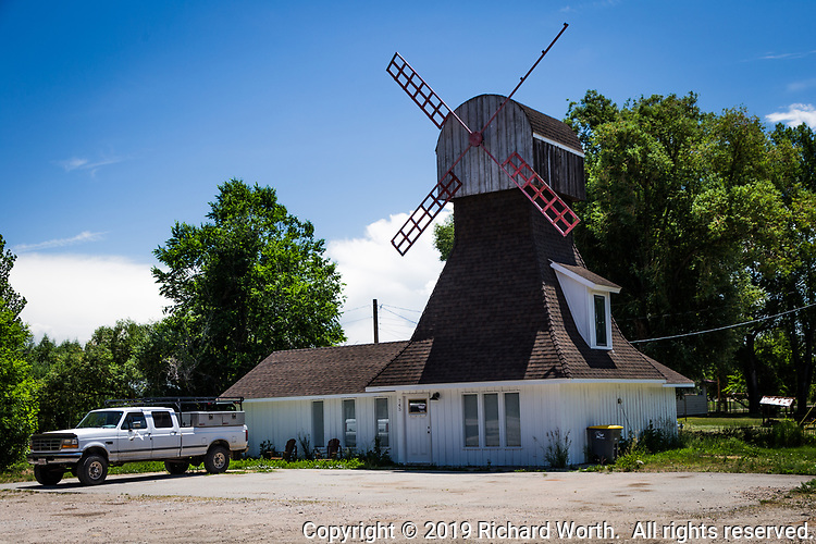 "Along US Route 40, at the edge of town in Hayden, Colorado, there is a windmill house.  From a web search:  The windmill was built in the 1970s for the Dutch Mill ""hamburger joint.""  Since then it has been a coffee shop and now appears to be a private home."
