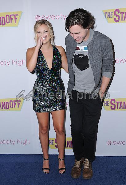 "08 September 2016 - Los Angeles, California. Olivia Holt, Ryan McCartan. ""The Standoff"" Los Angeles premiere held at Regal LA Live. Photo Credit: Birdie Thompson/AdMedia"