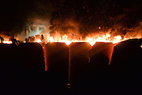The barricades are engulfed by the flames ignited by molotov cocktails used by the rioters during the   protest against new draconian law to ban the right to  protest across the country.  Kiev. Ukraine