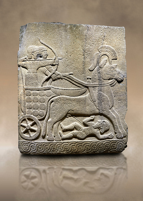 Photo ofHittite relief sculpted orthostat stone panel of Long Wall Basalt, Karkamıs, (Kargamıs), Carchemish (Karkemish), 900 - 700 B.C.  Anatolian Civilizations Museum, Ankara, Turkey<br /> <br /> Chariot. One of the two figures in the chariot holds the horse's headstall while the other throws arrows. There is a naked enemy with an arrow in his hip lying face down under the horse's feet. It is thought that this figure is depicted smaller than the other figures since it is an enemy soldier. The tower part of the orthostat is decorated with braiding motifs.<br /> <br /> On a brown art background.