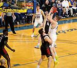 BROOKINGS, SD - FEBRUARY 8: Matt Dentlinger #32 of the South Dakota State Jackrabbits shoots over Matt Pile #40 of the Nebraska-Omaha Mavericks at Frost Arena February 8, 2020 in Brookings, South Dakota. (Photo by Dave Eggen/Inertia)