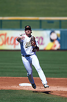 Mesa Solar Sox shortstop Sheldon Neuse (20), of the Oakland Athletics organization, makes a throw to first base during an Arizona Fall League game against the Peoria Javelinas on October 25, 2017 at Sloan Park in Mesa, Arizona. The Solar Sox defeated the Javelinas 6-3. (Zachary Lucy/Four Seam Images)