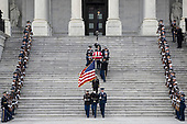 The flag-draped casket of former President George H.W. Bush is carried by a joint services military honor guard down the steps of the U.S. Capitol, Wednesday, Dec. 5, 2018, in Washington. (The New York Times via AP, Pool)<br /> Credit: Sarah Silbiger / Pool via CNP