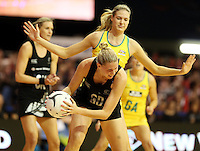 15.09.2013 Silver Ferns Casey Kopua and Australian Diamonds Caitlin Bassett in action during the Silver Ferns V Australian Diamonds New World Netball Series played at SIT Zero Fees Velodrome in Invercargill. Mandatory Photo Credit ©Michael Bradley.