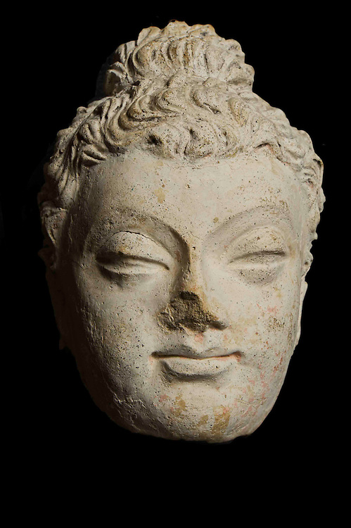 MES AYNAC, AFGHANISTAN - MAY 12 - head of buddha, plaster, height 16cm, 2nd-5th century CE