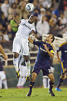 Real Madrid's Lassana Diarra leaps high over Landon Donovan of the LA Galaxy. Real Madrid beat the LA Galaxy 3-2 in an international friendly match at the Rose Bowl in Pasadena, California on Saturday evening August 7, 2010.