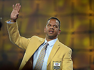 Canton, Ohio - August 1, 2014: Former NFL wide receiver Andre Reed waves to the audience after receiving his gold jacket during the Pro Football Hall of Fame's class of 2014 enshrinement dinner in Canton, Ohio  August 1, 2014. During his 16 seasons in the NFL, Reed had 13 seasons with 50 or more pass receptions (2nd in the NFL).  (Photo by Don Baxter/Media Images International)