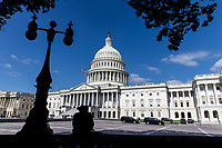 A mean wearing a cowboy hat sits in the shade near the United States Capitol Building on Capitol Hill in Washington, DC on June 6, 2018. <br /> <br /> CAP/MPI/RS<br /> &copy;RS/MPI/Capital Pictures