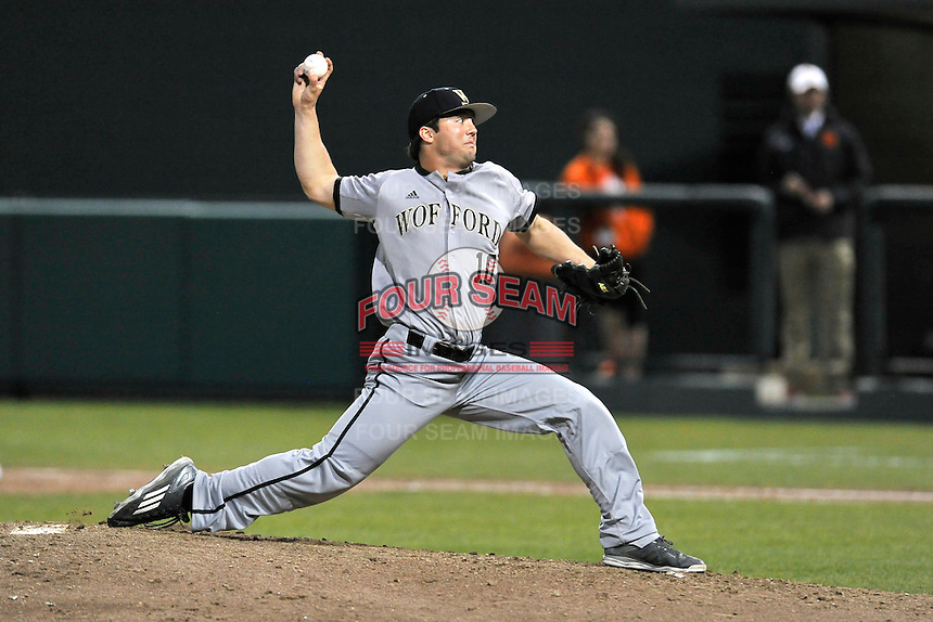 Pitcher Quintin Pile (10) of the Wofford College Terriers delivers a pitch in a game against the Clemson University Tigers on Tuesday, March 1, 2016, at Doug Kingsmore Stadium in Clemson, South Carolina. Clemson won, 7-0. (Tom Priddy/Four Seam Images)