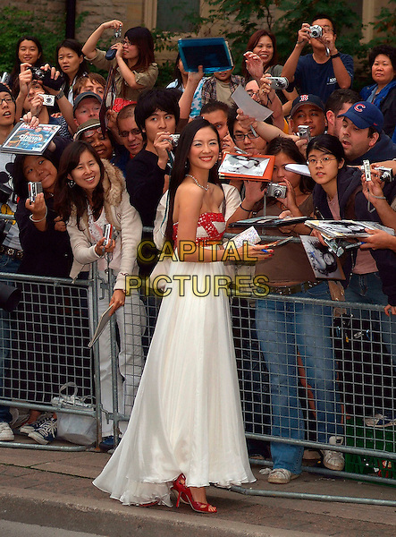 """ZIYI ZHANG.""""The Banquet"""" Premiere during the 2006 Toronto International Film Festival held at Roy Thomson Hall, Toronto, Ontario, Canada, .15 September 2006..full length strapless red beaded white dress clutch bag purse fans signing autographs.Ref: ADM/BP.www.capitalpictures.com.sales@capitalpictures.com.©Brent Perniac/AdMedia/Capital Pictures."""