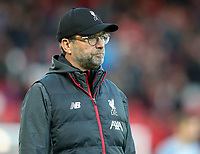27th October 2019; Anfield, Liverpool, Merseyside, England; English Premier League Football, Liverpool versus Tottenham Hotspur; Liverpool manager Jurgen Klopp watches his players during the pre-match warm up - Strictly Editorial Use Only. No use with unauthorized audio, video, data, fixture lists, club/league logos or 'live' services. Online in-match use limited to 120 images, no video emulation. No use in betting, games or single club/league/player publications