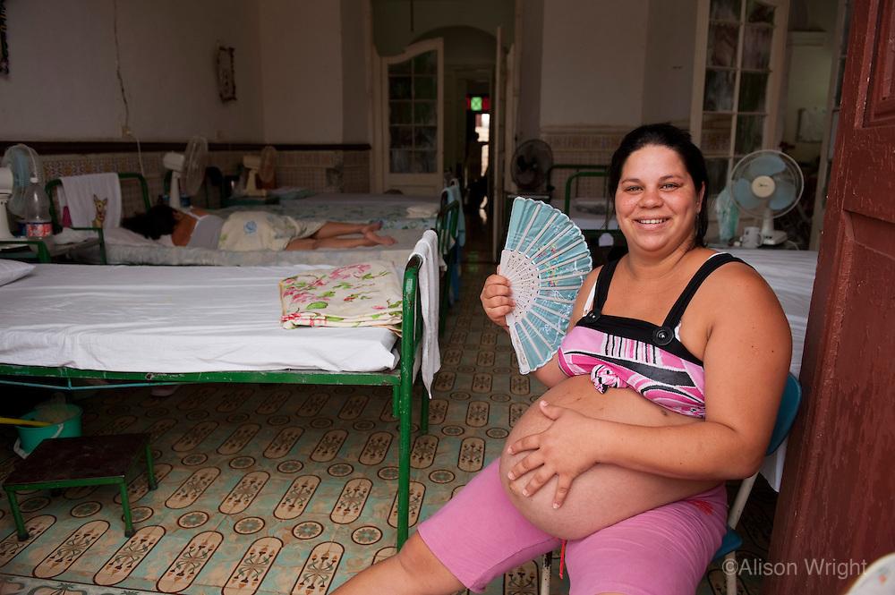 Pregnant woman in maternity ward.