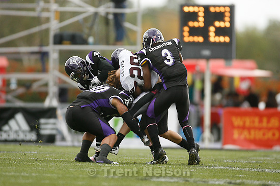 Trent Nelson  |  The Salt Lake Tribune.Weber defenders Marvin Walker (top left), Taylor Sedillo (bottom left) and Faron Creighton (right) force a fumble by Montana receiver Bryce Carver during the first half, Weber State vs. Montana, college football Saturday, October 30, 2010. 3, 30, 26