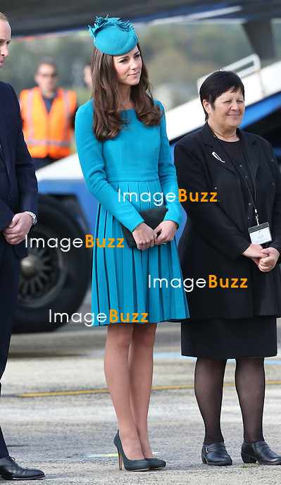 KATE, DUCHESS OF CAMBRIDGE AND PRINCE WILLIAM<br /> arrive at Dunedin airport, in New Zealand. The Royal couple were treated to a traditional welcome on their arrival. Kate delighted a five-year-old fan who greeted the couple on the tarmac by giving her a hug. Kate rubbed noses with Mataawhio Matahaere who handed the Duchess a book for Prince George, before wrapping her arms around the British royal's neck.<br /> 13/04/2014