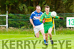 Moyvane's Conor Enright gets to ball first despite the close attention of Ballylongford's Stephrn Foley.