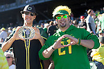 Marcus Laureta (Right) and Tanner Faris traveled from Eugene where they attend University of Oregon. They represented their school at the U of O pep rally on wednesday Jan. 2, 2013...Tribune Photo: Meg Williams..1-2-13, DUCKS, U OF O, Fiesta bowl, pep rally, Tostitos Fiesta Bowl, University of Oregon, Phoenix, Saltwater Fields