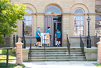 Adam DaSilva,'21, left, and Donovan Montville,'21, along with other Salve Regina University volunteers, move boxes to the Redwood Library as they participate in the Exploration Day of Service in Newport.
