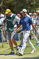 Shubhankar Sharma (IND) and his caddie share a laugh as they depart the 3rd tee during round 4 of the World Golf Championships, Mexico, Club De Golf Chapultepec, Mexico City, Mexico. 3/4/2018.<br /> Picture: Golffile | Ken Murray<br /> <br /> <br /> All photo usage must carry mandatory copyright credit (© Golffile | Ken Murray)