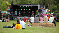 Pictured: People watch a folk performance on stage Saturday 13 August 2016<br />