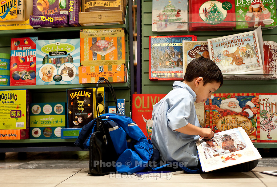 Joe Garcia IV (cq, age 6) reads at a B. Dalton book store, the only book store in Laredo, Texas, US, Wednesday, Dec., 9, 2009. The Laredo, Texas community has voiced its opposition to the closing of the B. With over 95 percent of the population as Hispanic Spanish speakers, Laredo ranked the lowest in literacy rates in the 2000 US census. ..PHOTOS/ MATT NAGER