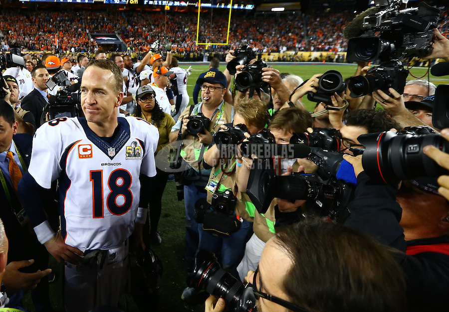 Feb 7, 2016; Santa Clara, CA, USA; Denver Broncos quarterback Peyton Manning (18) is surrounded by photographers and media in the closing seconds of the game against the Carolina Panthers in Super Bowl 50 at Levi's Stadium. Mandatory Credit: Mark J. Rebilas-USA TODAY Sports