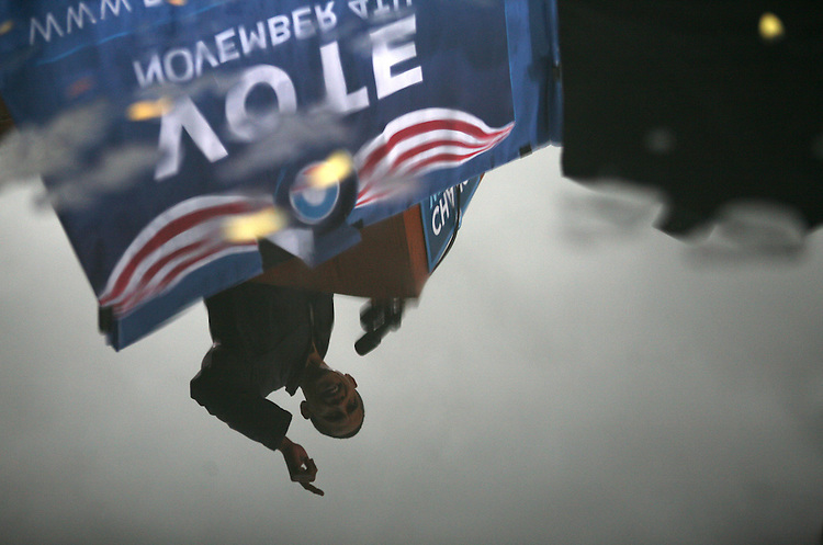 Democratic presidential candidate Sen. Barack Obama, D-Ill. addresses supporters in rain at a rally in Chester, Pa., Tuesday, Oct. 28, 2008.