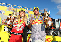 Feb 26, 2017; Chandler, AZ, USA; NHRA top fuel driver Leah Pritchett celebrates alongside funny car driver Matt Hagan after winning the Arizona Nationals at Wild Horse Pass Motorsports Park. Mandatory Credit: Mark J. Rebilas-USA TODAY Sports