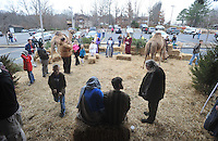 NWA Media/Michael Woods --12/21/2014-- w @NWAMICHAELW...Visitors mingle with the actors and animals at the living nativity at the Bella Vista Christian Church Sunday evening. This is the second year for the church to offer the live nativity to the community, which includes  a new feature of  live camels for this years display.