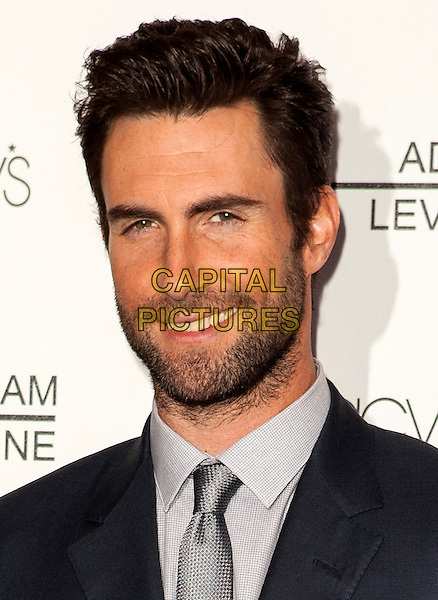 Adam Levine.Adam Levine attends the launch of his debut fragrance, Adam Levine, at Macy's.Century City on February 7, 2013 in Los Angeles, CA, USA, 7th February 2013..portrait headshot beard facial hair smiling tanned silver tie grey gray shirt blue navy suit .CAP/ADM/ES.©Emiley Schweich/AdMedia/Capital Pictures.