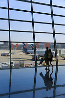 Two people silhouette in front of a big window in Moscow airport Sheremetyevo D
