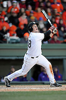 Catcher Taylor Hunter (38) of the South Carolina Gamecocks bats in the Reedy River Rivalry game against the Clemson Tigers on Saturday, February 28, 2015, at Fluor Field at the West End in Greenville, South Carolina. South Carolina won, 4-1. (Tom Priddy/Four Seam Images)