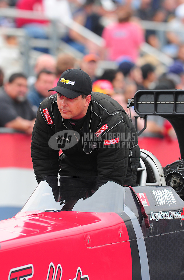 Nov. 10, 2011; Pomona, CA, USA; NHRA top fuel dragster driver Todd Paton during qualifying at the Auto Club Finals at Auto Club Raceway at Pomona. Mandatory Credit: Mark J. Rebilas-.