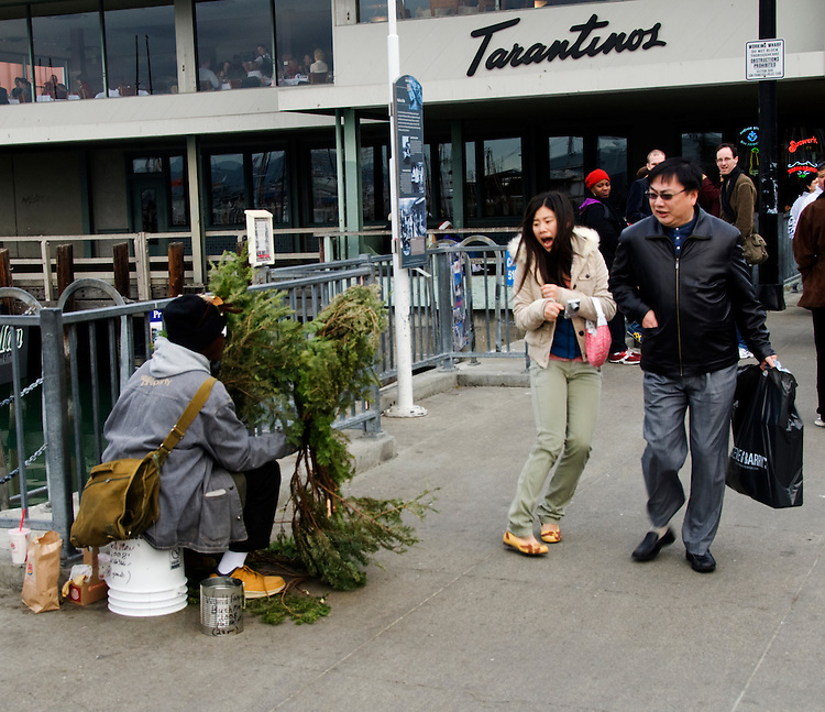 "California, San Francisco: The ""Bushman"" street artist frightening tourists at Fisherman's Wharf..Photo #: 12-casanf75991.Photo © Lee Foster 2008"