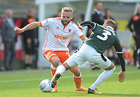 Blackpool's Ryan McLaughlin is tackled by Plymouth Argyle's Gary Sawyer<br /> <br /> Photographer Kevin Barnes/CameraSport<br /> <br /> The EFL Sky Bet League One - Plymouth Argyle v Blackpool - Saturday 15th September 2018 - Home Park - Plymouth<br /> <br /> World Copyright &copy; 2018 CameraSport. All rights reserved. 43 Linden Ave. Countesthorpe. Leicester. England. LE8 5PG - Tel: +44 (0) 116 277 4147 - admin@camerasport.com - www.camerasport.com