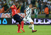MEDELLIN - COLOMBIA -15 -03-2015: Jairo Palomino (Der.) jugador de Atletico Nacional disputa el balón con Juan Caicedo (Izq.) jugador de Deportivo Independiente Medellin, durante partido entre Atletico Nacional y Deportivo Independiente Medellin por la fecha 10 la Liga Aguila I 2015, jugado en el estadio Atanasio Girardot de la ciudad de Medellin.  / Jairo Palomino (R), player of Atletico Nacional fights for the ball with Juan Caicedo (L) player of Deportivo Independiente Medellin during a match for the date 10 between Atletico Nacional and Deportivo Independiente Medellin the Liga Aguila I 2015 at the Atanasio Girardot stadium in Medellin city. Photo: VizzorImage. / Leon Monsalve / Str.